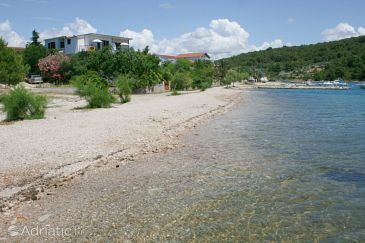 Property Pirovac (Šibenik) - Accommodation 6429 - Apartments near sea with pebble beach.