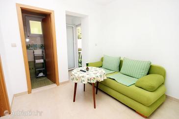 Drvenik Donja vala, Dining room u smještaju tipa apartment, dostupna klima i WIFI.