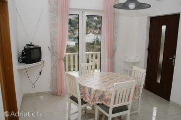 Postira, Dining room u smještaju tipa apartment, dostupna klima, dopusteni kucni ljubimci i WIFI.