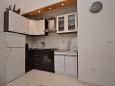 Kitchen - Apartment A-7550-b - Apartments Sumpetar (Omiš) - 7550