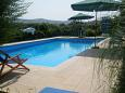 Courtyard Seget Vranjica (Trogir) - Accommodation 7559 - Apartments with pebble beach.