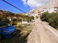 Parking lot Duće (Omiš) - Accommodation 7576 - Apartments near sea with sandy beach.