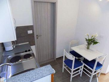 Mošćenice, Dining room u smještaju tipa studio-apartment, dopusteni kucni ljubimci i WIFI.