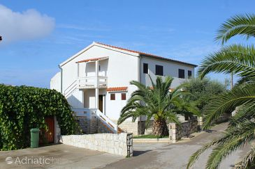 Property Novalja (Pag) - Accommodation 9335 - Apartments with pebble beach.