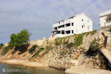 Property Vlašići (Pag) - Accommodation 9385 - Apartments near sea with pebble beach.
