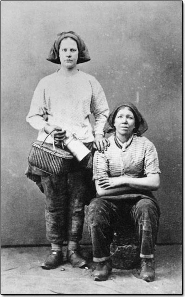 Photograph of two women in work clothes