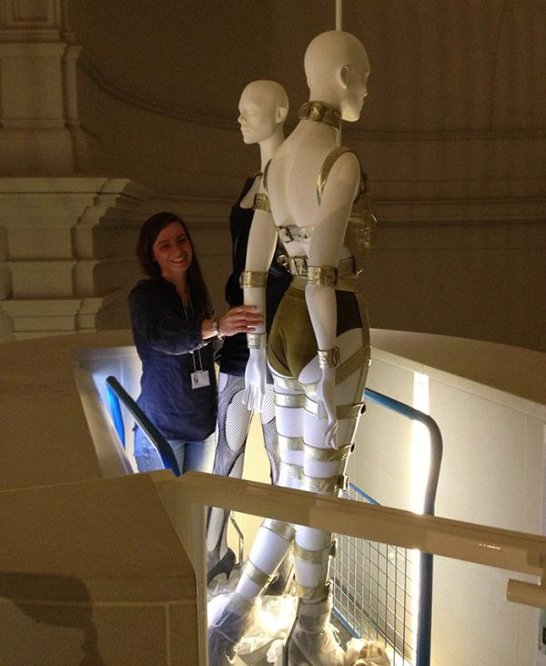 Exhibition assistant Jemma Davey transports some mannequins to the mezzanine in the lift