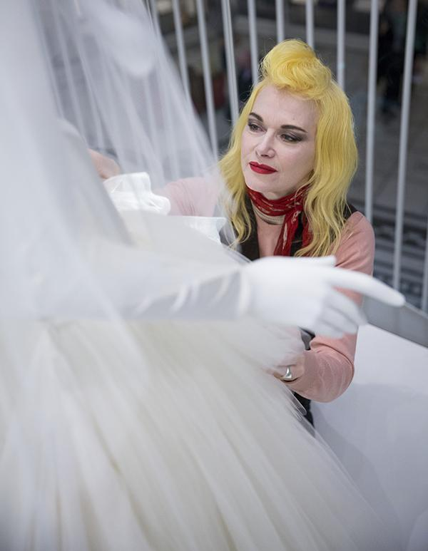 Pam Hogg makes sure the tulle skirt is sitting correctly. © Victoria & Albert Museum, London