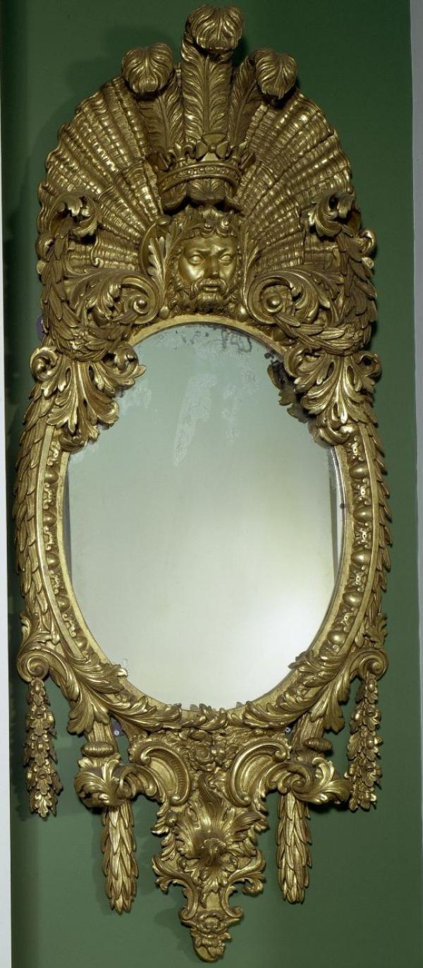 A giltwood mirror probably designed by Kent for Frederick, Prince of Wales, c.1730