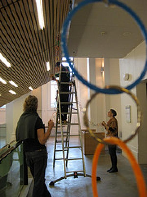 Heather Whitely directing chain hanging operationsn