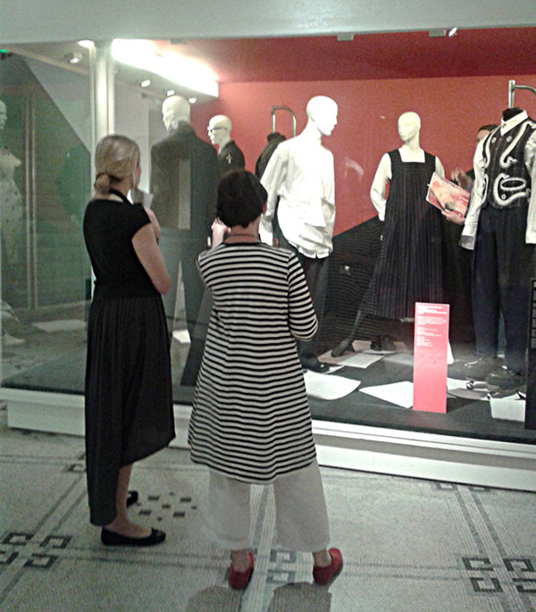 Curators contemplating a case