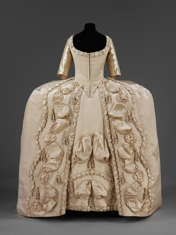 This dress will have been worn by a bride for her presentation at court as a married woman, 1775-80