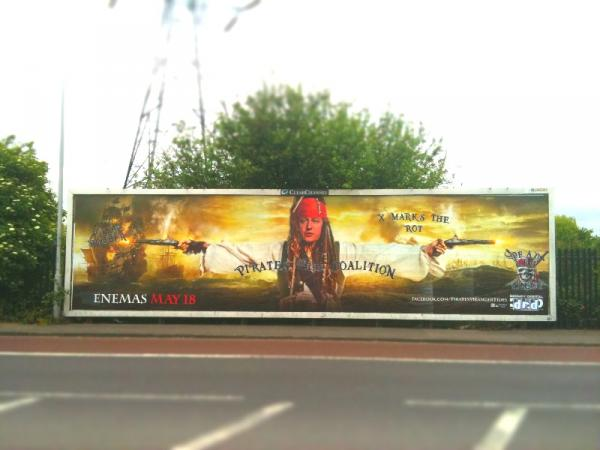 Doctored film poster on a billboard in London