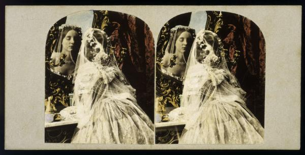Stereoscopic image of a woman looking in a mirror