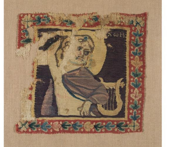 Square panel of cloth with a depiction of Apollo and his lyre, tapestry woven wool & linen, Egyptian, 300 - 499.
