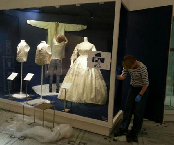 Arranging the objects in 'The Victorian Wedding' section. © Victoria and Albert Museum, London