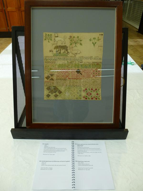 One of the frames containing the oldest dated sampler in our collection