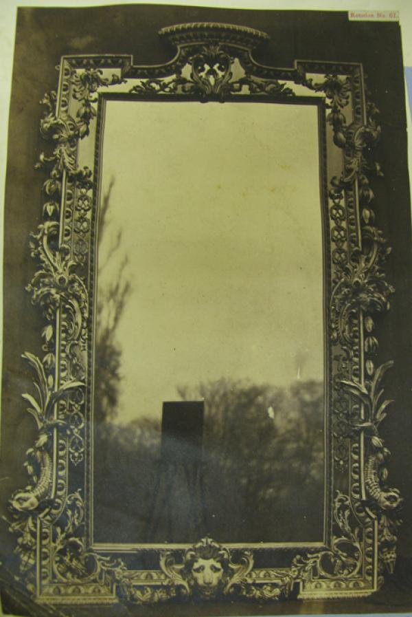 Mirror in carved wood frame. English, date about 1730