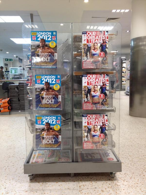 tesco news stand with Olympic headlines