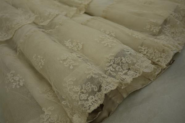 Photograph of the cleaned hem of the wedding dress