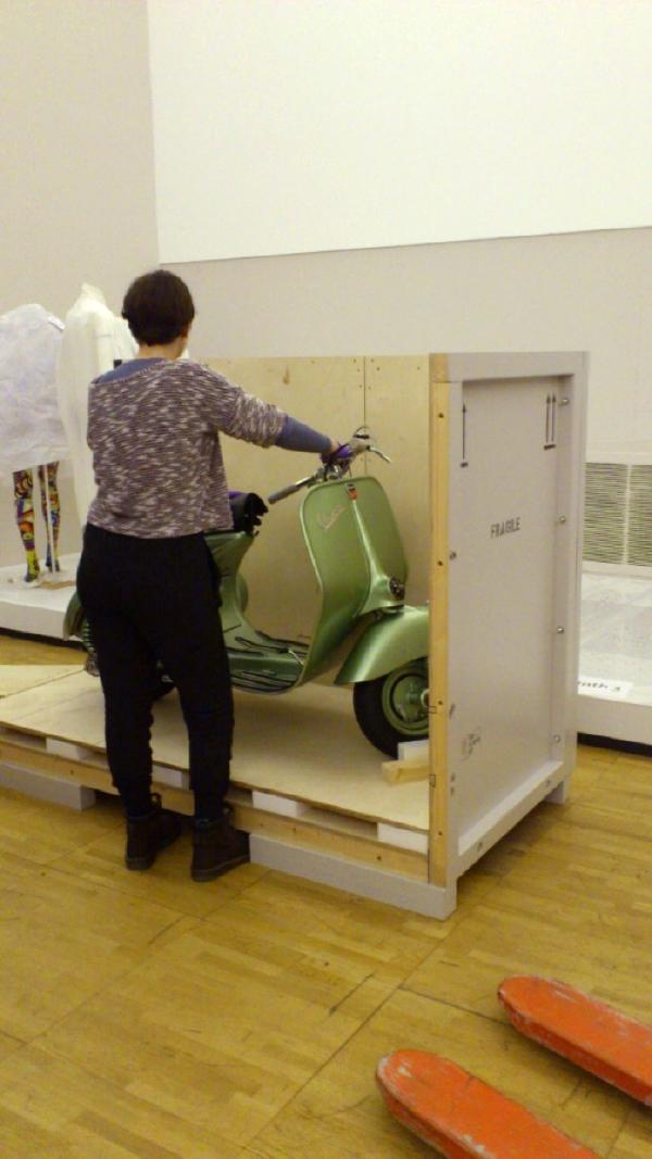 Removing the Vespa from its crate during installation © Matthew Philips, Vespa 125, 1949 Model; Photo  © Victoria and Albert Museum, London