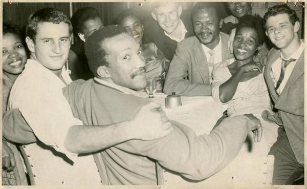 An illegal gathering in S.A. in the late 50s. The Xhosa princess and Ian side by side – years ahead of their time at a Shebeen party in Woodstock. © Ian Rakoff