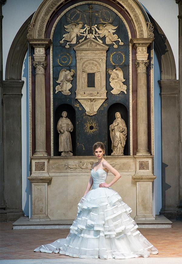 Photo call of model Jenny Bishop wearing an Ian Stuart Wedding Dress of taffeta & beaded metallic lace. © Victoria and Albert Museum, London
