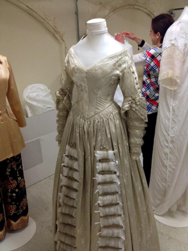 On its arrival back into the V&A's collection, the dress had cushions inserted into skirt's decoration to protect it. © V&A Collection