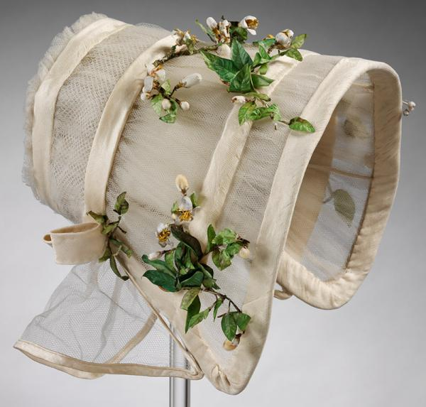 Wedding bonnet made of silk tulle, crêpe, and imitation orange blossom, 1845. © Victoria and Albert Museum, London