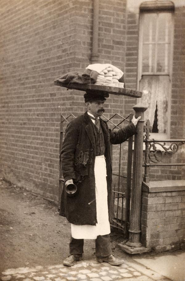 Photograph showing a man in a cap with a board laden with bread balanced on his head, Edgar Scamell, 1895. Museum no. E.3608-2000, © Victoria and Albert Museum, London