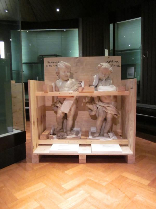 Two French 18th century marble statuettes in the process of being crated