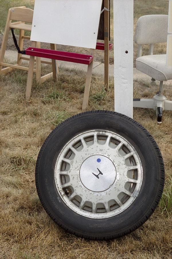'Honda Wheel', 2008, New York State, 70 x 47 cm, Archival Pigment print,series: Yard Sale, Adam Bartos © Prix Pictet Ltd 2013/14