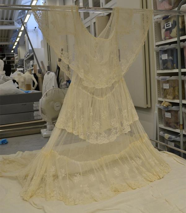 Drying the wedding dress on a suspended rail