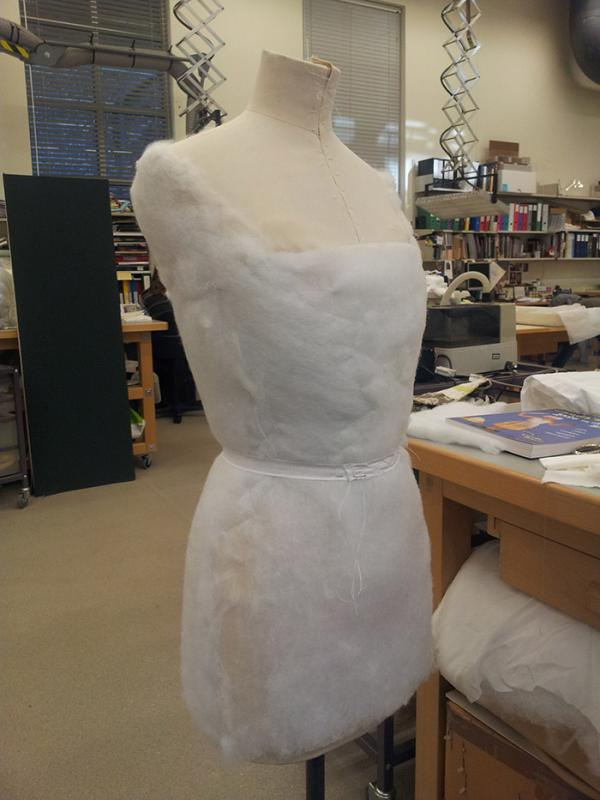 Padding up the figure to an 18th century shape