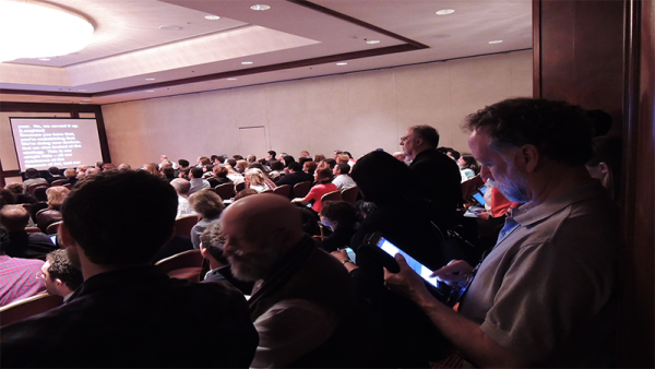 Sessions at MW2014 are digitally interconnected. It is possible to attend one and monitor another on Twitter due to a healthy community picking out and sending highlights round.