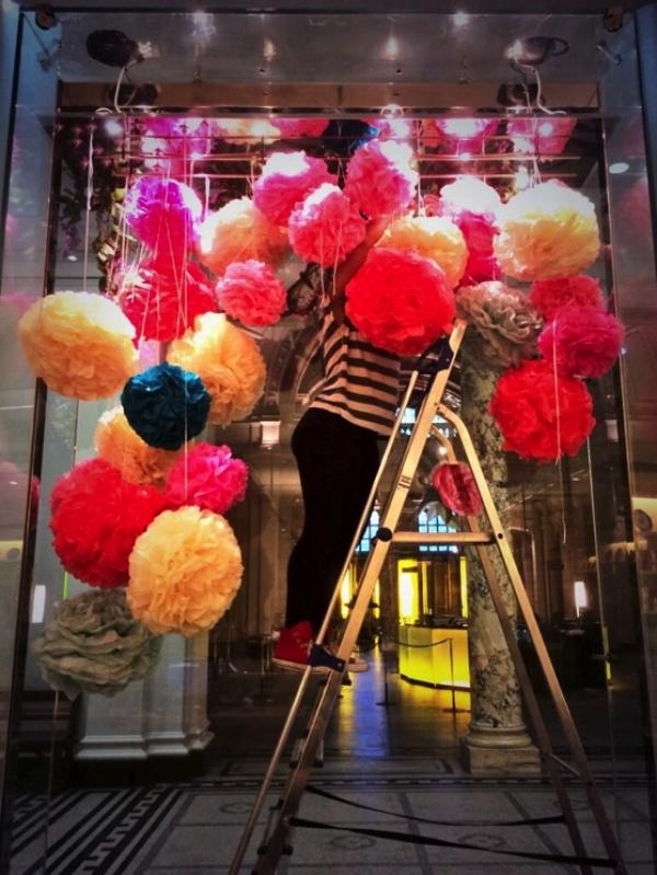 V&A Shop staff hanging pom poms