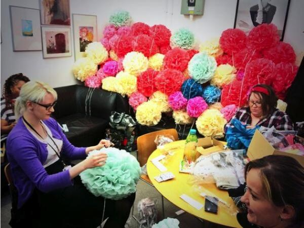 The V&A Shop team making paper pom poms