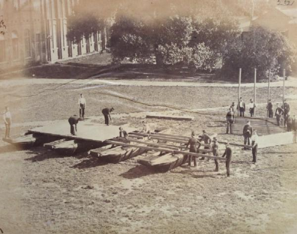 Sappers constructing a pontoon on dry land