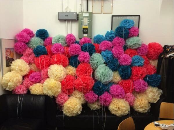 132 paper pom poms on a sofa