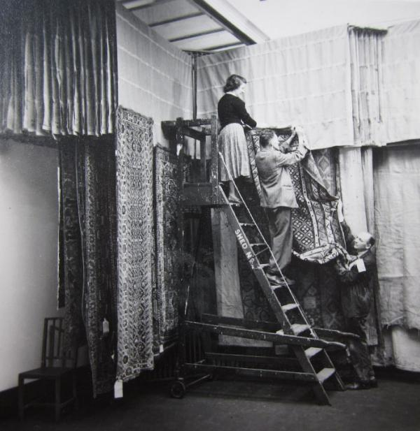 V&A staff hanging carpets in 1951