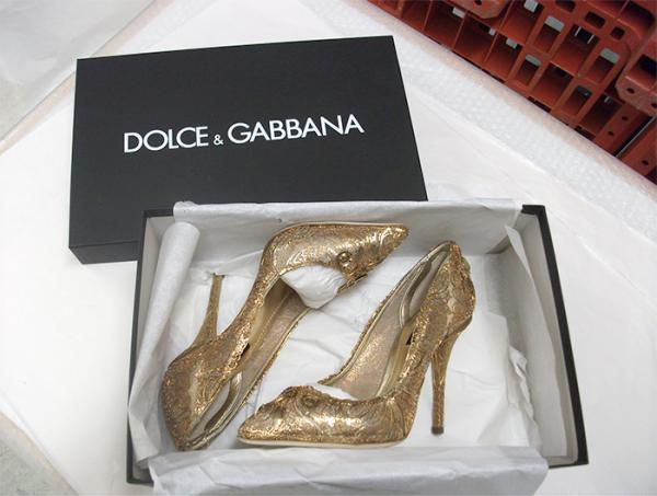 Gold Dolce and Gabbana shoes. © Victoria and Albert Museum, London.