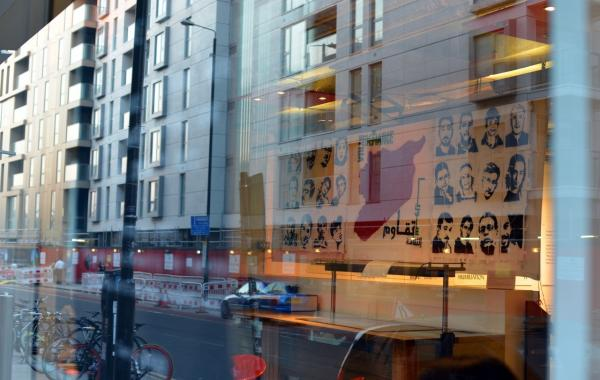 reflection of a banner in the window of the Ricgh Mix Gallery, London