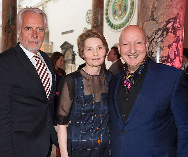 The curator Edwina Ehrman, in a dress by Anna Valentine, with the V&A's director Martin Roth and milliner Stephen Jones. © Victoria and Albert Museum, London