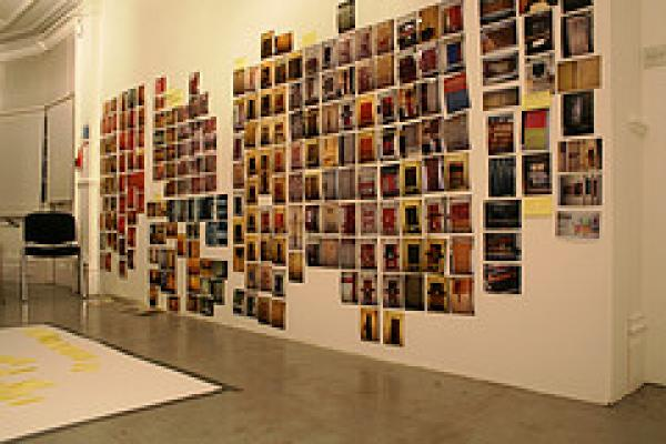 massed photos on the wall