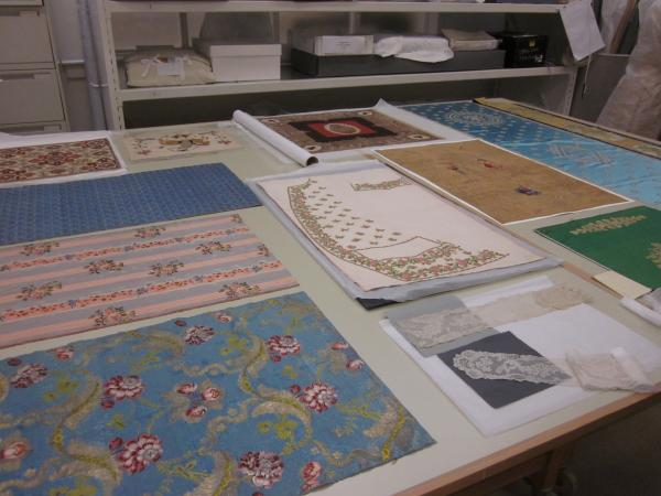 A selection of textiles which will be mounted on boards for display in the galleries