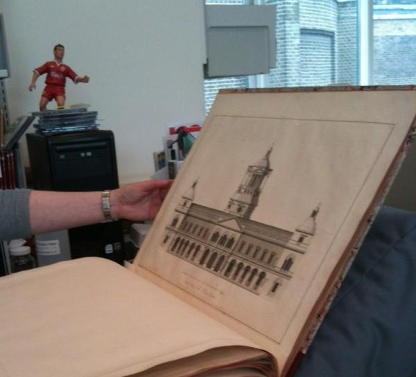 A volume for the William Kent exhibition is measured in the Conservation studio.