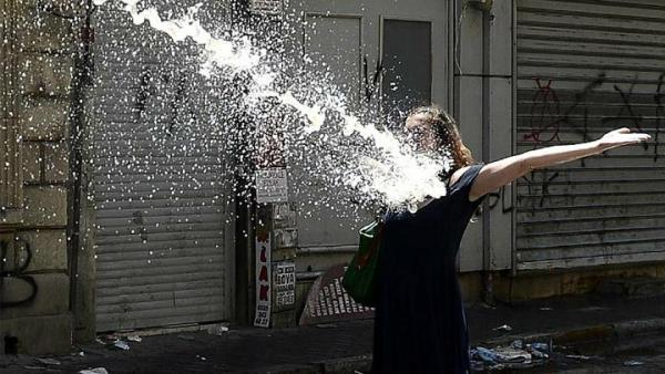 Photo of a girl being hit by a water cannon