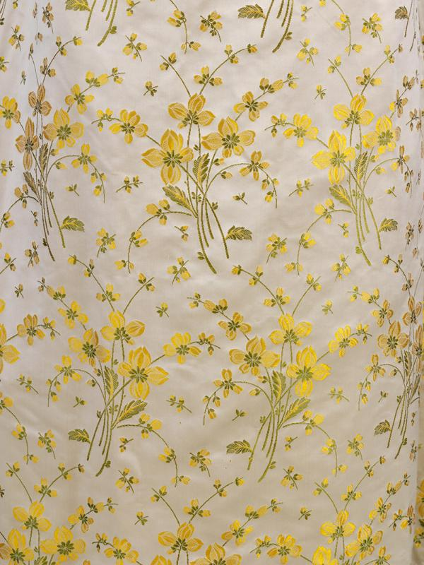 Buttercup print satin curtain material used for Elizabeth King's wedding dress, 1941. © Victoria and Albert Museum, London