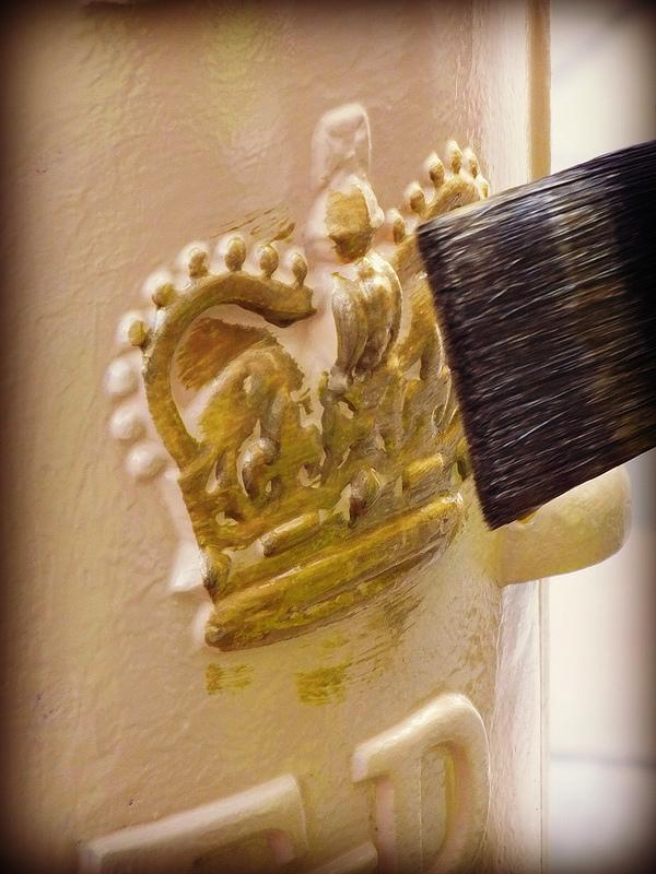 Letter box being painted gold