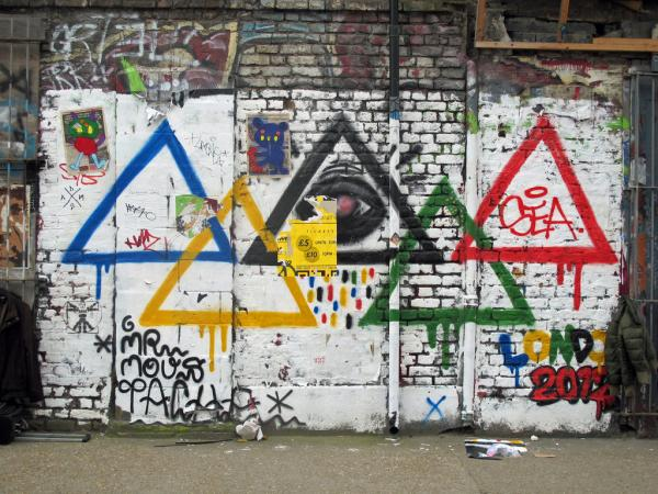 Street art of Olympic rings as triangles